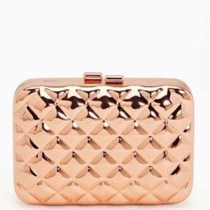 H&M gold metal quilted clutch